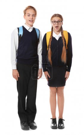 Teenagers with backpacks holding books