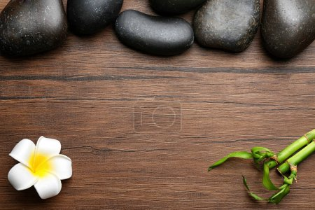 Spa stones, plumeria flower and bamboo
