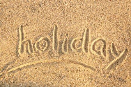 Handwritten inscription on sea sand