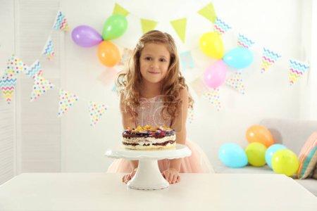 Pretty girl with birthday cake