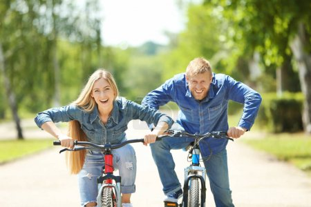 Happy couple with bicycle