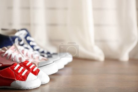 Family concept. Shoes for parents and child on flo...