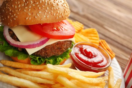 Tasty burger with snacks