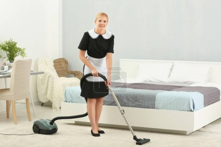 Chambermaid cleaning room