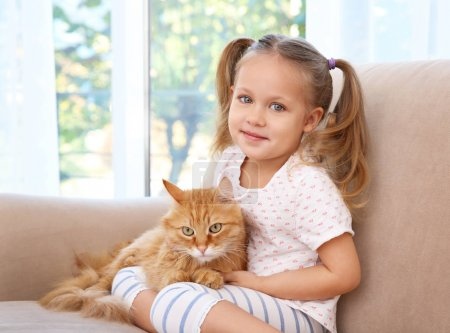Cute little girl with red cat