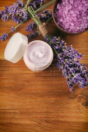 Nourishing cream and lavender flowers
