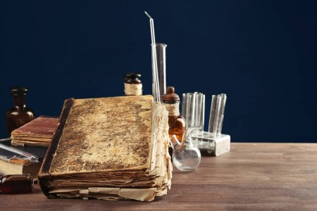 Vintage medicine bottles and books