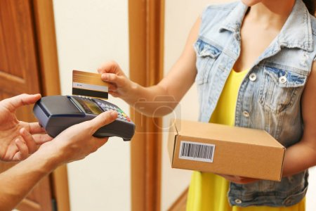 woman paying for parcel