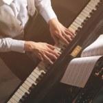 Man hands playing piano, close up...