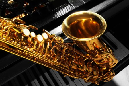 Photo for Piano and saxophone, closeup - Royalty Free Image