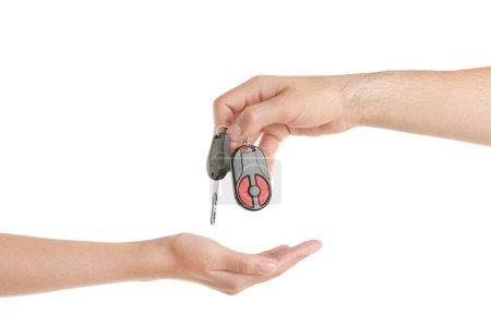 Male hand giving car key