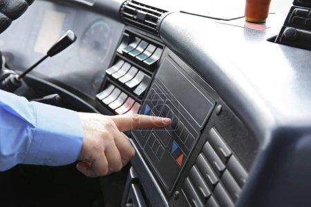 Bus driver  pushing button