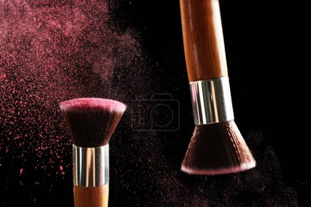 Make-up brushes with pink powder