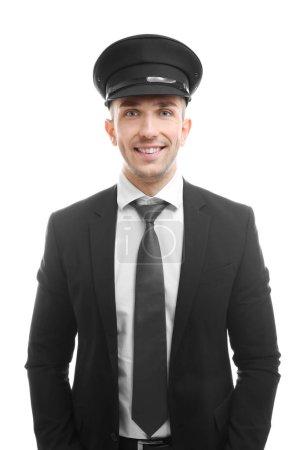 Photo pour Jeune chauffeur debout sur fond blanc - image libre de droit