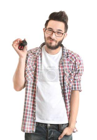 Young man holding car key