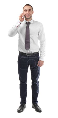 Young business coach speaking by cellphone on white background