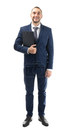 Young business coach with clipboard standing on white background