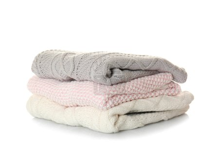 Photo for Stack of warm winter clothes on white background - Royalty Free Image
