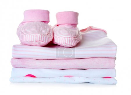 Baby shoes and pile of clothes