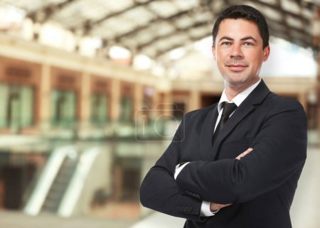 Man on shopping mall background. Wholesale and logistics concept