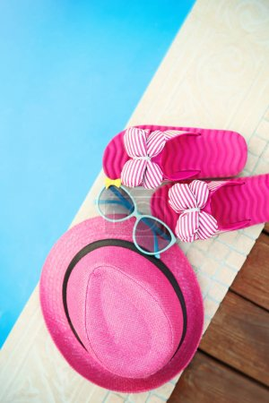 hat, sunglasses and flip flops