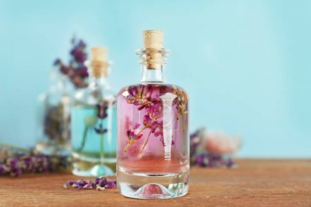 Bottles with lavender oil and flowers