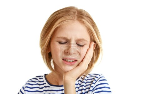 Upset girl with toothache