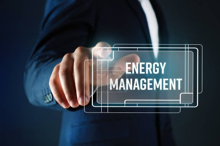 Photo for Man pushing ENERGY MANAGEMENT button on virtual screen - Royalty Free Image
