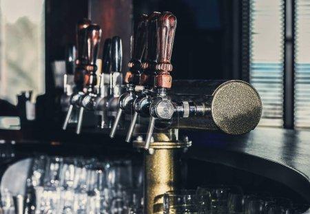 Draft beer taps in bar