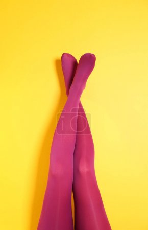 woman legs in color tights