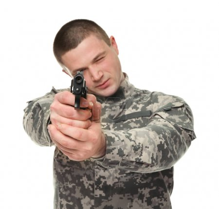 Soldier with pistol on white background