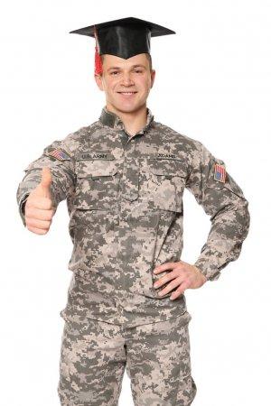 Soldier wearing graduation cap, on white background