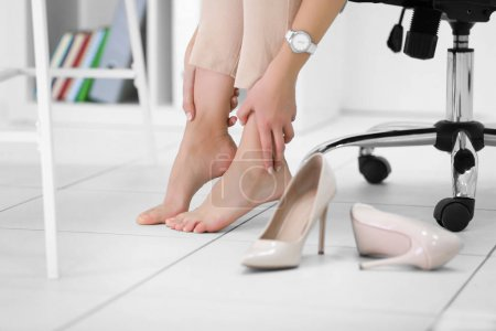 Barefoot woman in office