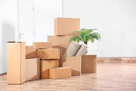 Photo for Pile of boxes for moving in office - Royalty Free Image