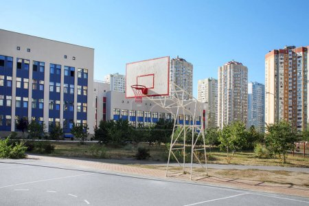 Photo for School yard with basketball court and modern buildings on background - Royalty Free Image