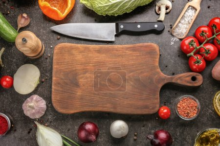Photo for Cutting board and vegetables on gray background - Royalty Free Image