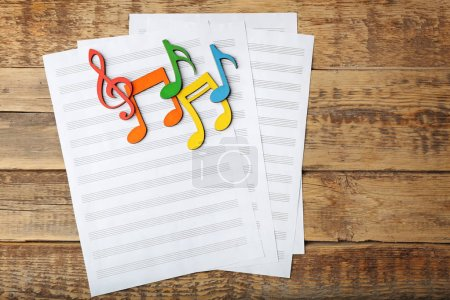 Music notes and sheets of paper
