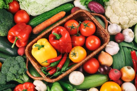 Photo for Wicker basket with fresh vegetables on background - Royalty Free Image