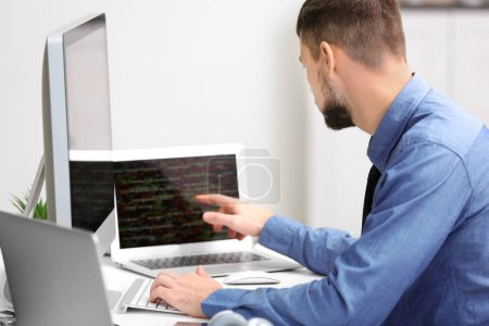 Photo for Handsome young programmer working in office - Royalty Free Image