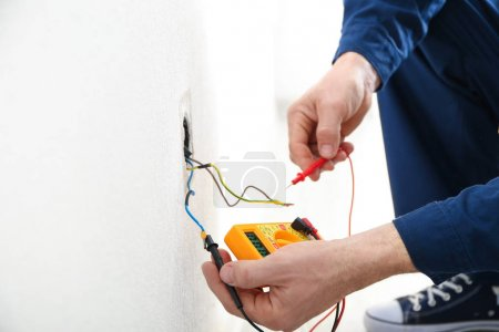 Electrician measuring earth resistance
