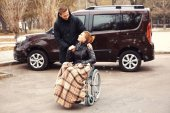 Young man with woman in wheelchair