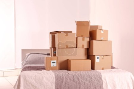 Photo for Packed household stuff for moving into new house - Royalty Free Image