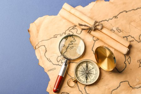 Compass, scroll, magnifier and old map