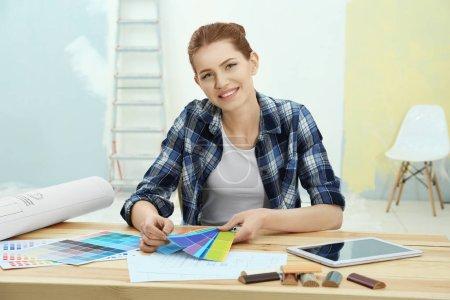 Female decorator choosing colors