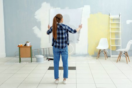 Young female decorator with drawing