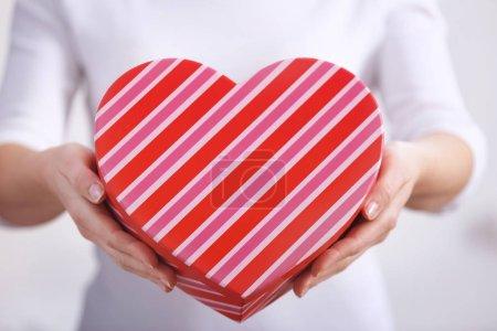 Woman holding beautiful gift box