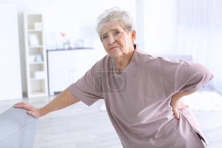 Elderly woman suffering from backache