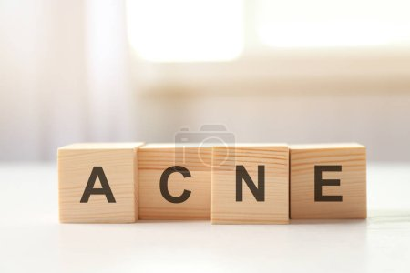 Word ACNE of wooden cubes
