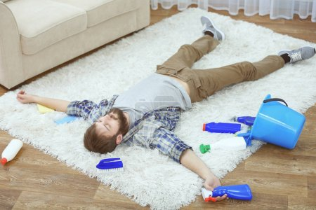 man tired of cleaning carpet