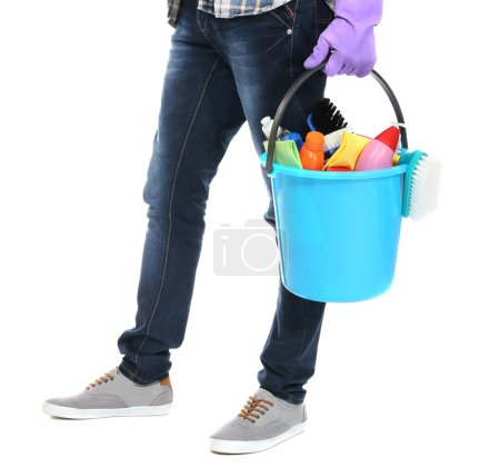 Man holding bucket with cleaning equipment